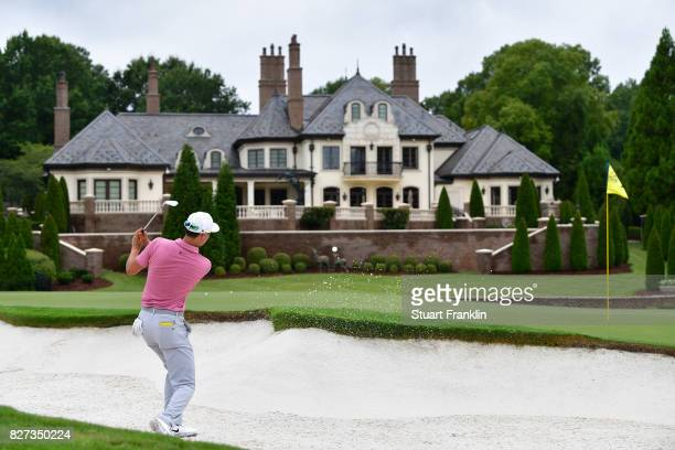 Haotong Li of China hits out of a bunker during a practice round prior to the 2017 PGA Championship at Quail Hollow Club on August 7 2017 in...