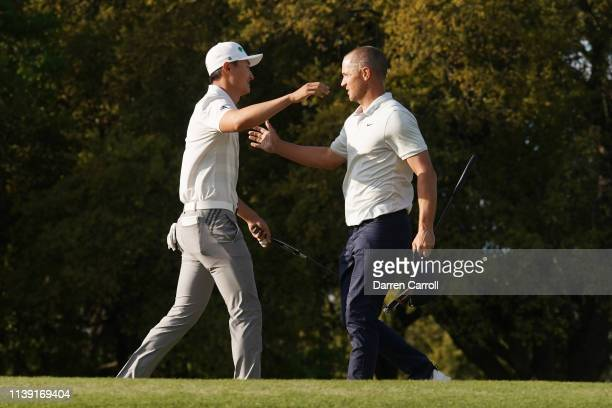 Haotong Li of China hugs Alexander Noren of Sweden after defeating him during a playoff on the first hole during the third round of the World Golf...