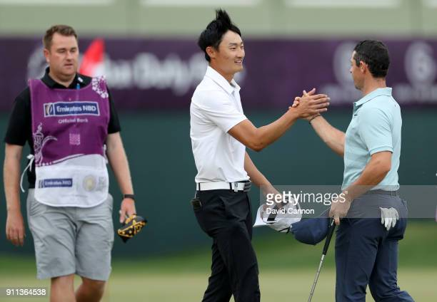 Haotong Li of China is congratulated by Rory McIlroy of Northern Ireland after Li had won by a single shot during the final round of the Omega Dubai...