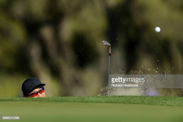 Haotong Li of China plays a shot from a bunker on the first hole during the second round of the World Golf ChampionshipsDell Match Play at Austin...