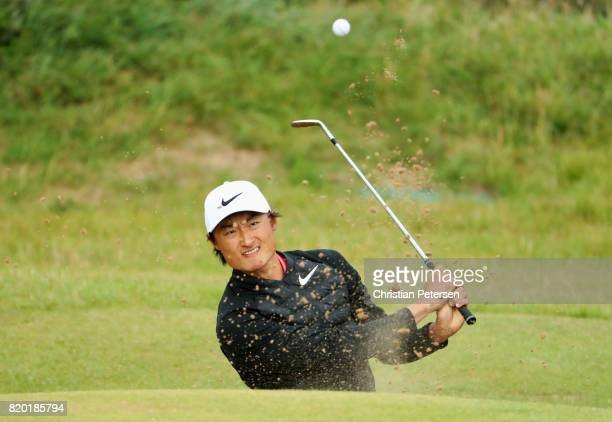 Haotong Li of China plays from a bunker on the 12th hole during the second round of the 146th Open Championship at Royal Birkdale on July 21 2017 in...
