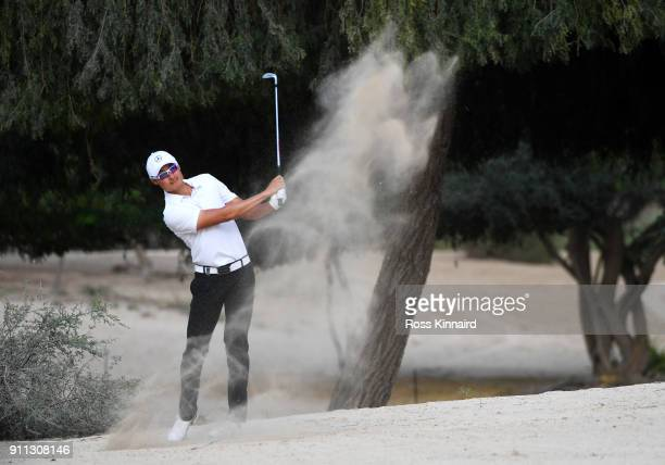 Haotong Li of China plays his second shot on the 14th hole during the final round on day four of the Omega Dubai Desert Classic at Emirates Golf Club...