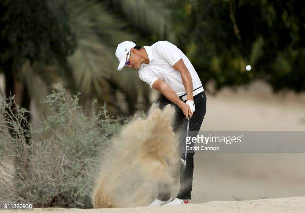 Haotong Li of China plays his second shot on the par 4 14th hole during the final round of the Omega Dubai Desert Classic on the Majlis Course at...