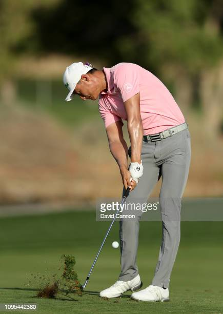Haotong Li of China plays his second shot on the par 4 16th hole during Day Two of the Abu Dhabi HSBC Golf Championship at Abu Dhabi Golf Club on...