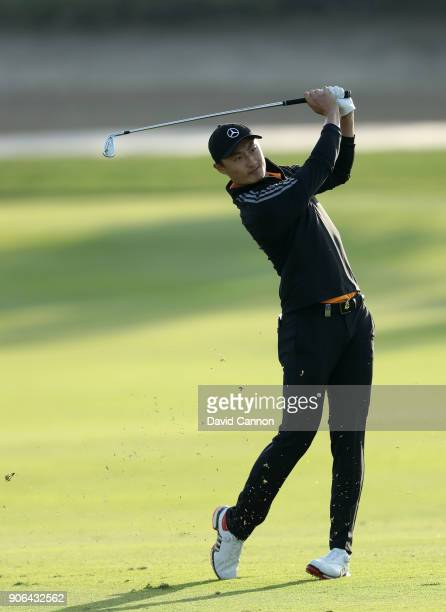Haotong Li of China plays his second shot on the par 4 17th hole during the first round of the 2018 Abu Dhabi HSBC Golf Championship at the Abu Dhabi...