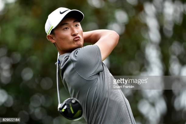 Haotong Li of China plays his shot from the 16th tee during the first round of the 2017 PGA Championship at Quail Hollow Club on August 10 2017 in...