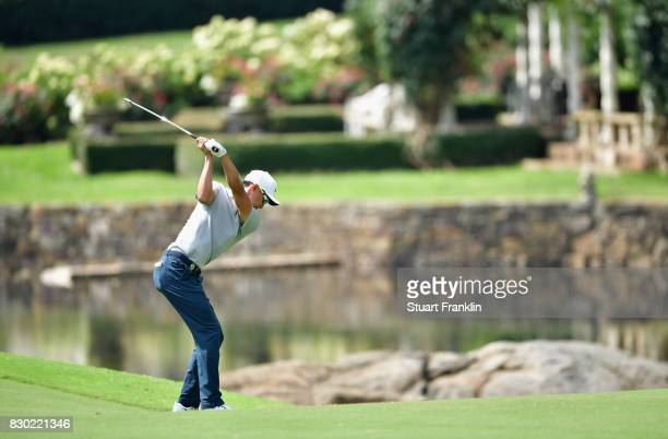 Haotong Li of China plays his shot on the seventh hole during the second round of the 2017 PGA Championship at Quail Hollow Club on August 11 2017 in...