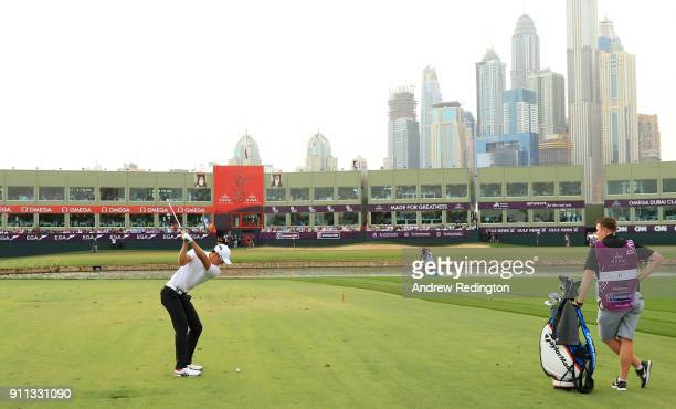 Haotong Li of China plays his third shot on the 18th hole during the final round on day four of the Omega Dubai Desert Classic at Emirates Golf Club...