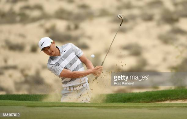 Haotong Li of China plays his third shot on the 8th hole during the first round of the Omega Dubai Desert Classic at Emirates Golf Club on February 2...