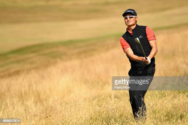 Haotong Li of China plays out of the rough on hole one during day three of the Aberdeen Standard Investments Scottish Open at Gullane Golf Course on...