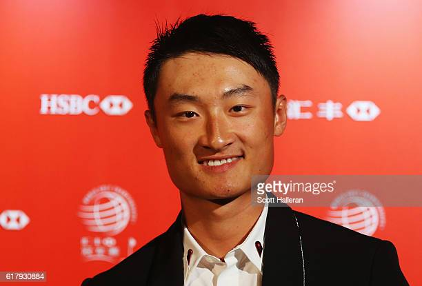 Haotong Li of China poses at the Himalayas Centre for a photocall prior to the start of the WGC HSBC Champions on October 25 2016 in Shanghai China