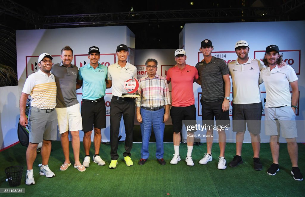 Haotong Li (4thL) of China poses with the winners trophy and (L-R) Francesco Molinari of Italy, Ian Poulter of England, Rafa Cabrera Bello of Spain, Pawan Munjal, Chairman, Managing Director and CEO of Hero MotoCorp, Alex Noren of Sweden, Thomas Pieters of Belgium, Jon Rahm of Spain and Tommy Fleetwood of England after the Hero Challenge prior to the DP World Tour Championship at Atlantis, The Palm on November 14, 2017 in Dubai, United Arab Emirates.