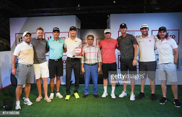 Haotong Li of China poses with the winners trophy and Francesco Molinari of Italy Ian Poulter of England Rafa Cabrera Bello of Spain Pawan Munjal...