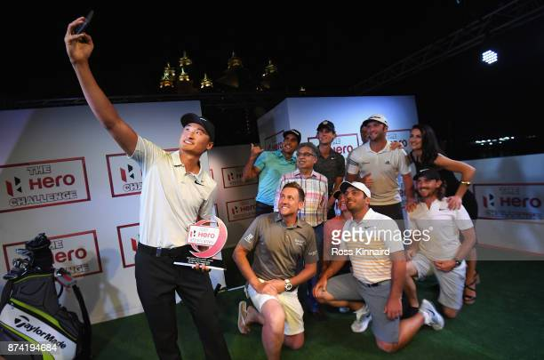 Haotong Li of China takes a selfie with the winners trophy and Francesco Molinari of Italy Ian Poulter of England Rafa Cabrera Bello of Spain Pawan...