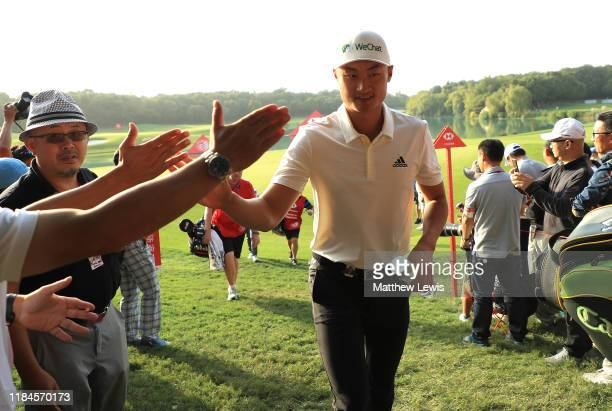 Haotong Li of China walks off the 9th green after his round during Day one of the WGC HSBC Champions at Sheshan International golf club on October 31...