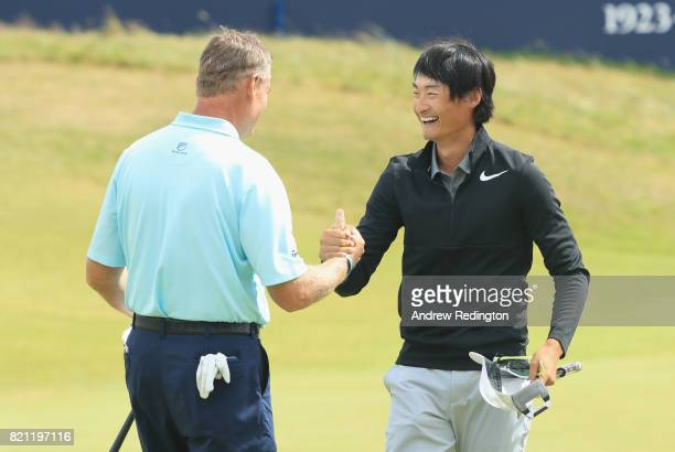 Haotong Li of China with Ernie Els of South Africa on the 18th green during the final round of the 146th Open Championship at Royal Birkdale on July...