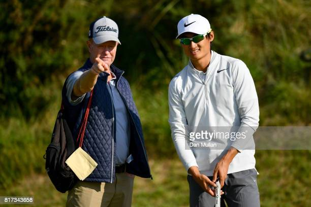 Haotong Li of China with his swing coach Jamie Gough during a practice round prior to the 146th Open Championship at Royal Birkdale on July 18 2017...