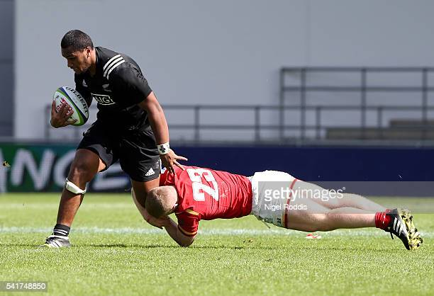 Hapakuki MoalaLiava'a of New Zealand tackled by Kieran Williams of Wales during the World Rugby U20 Championship 5th Place Semi Final between New...