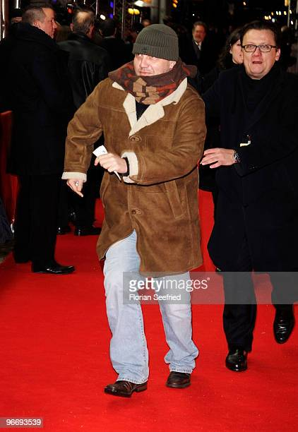 Hape Kerkeling runs into the cinema at the 'Die Friseuse' Premiere during day four of the 60th Berlin International Film Festival at...