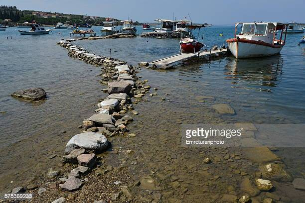 s haped path with rocks and sacks in the bay - emreturanphoto stock pictures, royalty-free photos & images