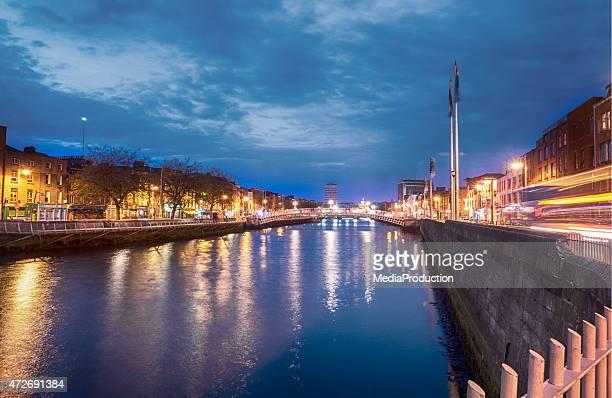 Hapenny bridge in Dublin Ireland over river liffey