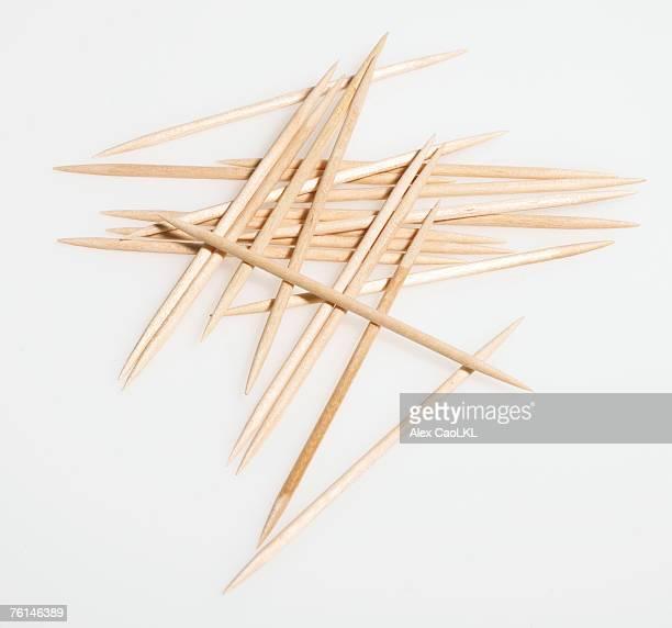 Haphazard arrangement of toothpicks against white background