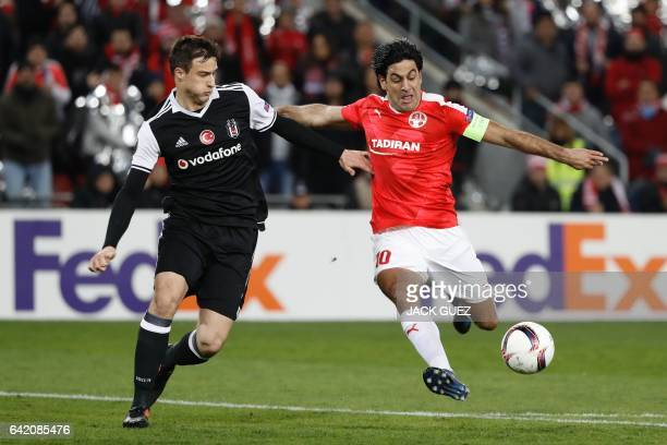 Hapoel Beersheba's Israeli forward Elyaniv Barda shoots past Besiktas's Croatian defender Matej Mitrovic during the UEFA Europa League football match...