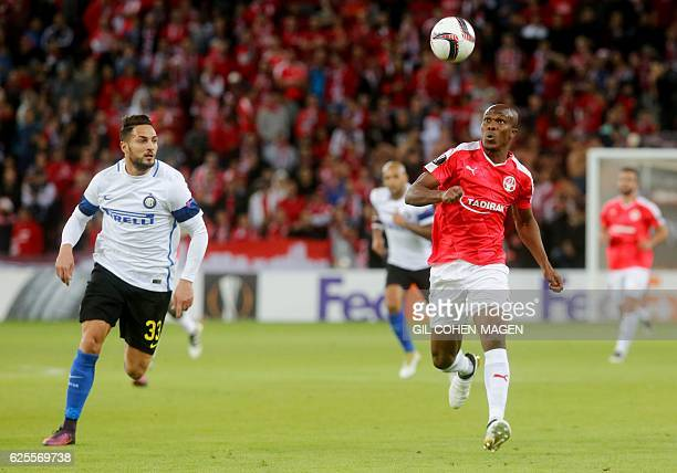 Hapoel's Anthony Nwakaeme vies for the ball with Inter Milan's Danilo d'Ambrosio during the UEFA Europa League group K football match between...