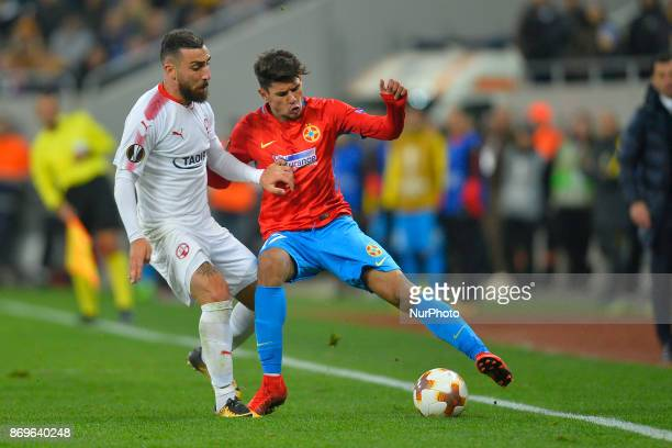 Hapoel's Dor Elo vies Steaua's Florinel Coman during the UEFA Europa League 20172018 Group Stage Groupe G game between FCSB Bucharest and Hapoel...