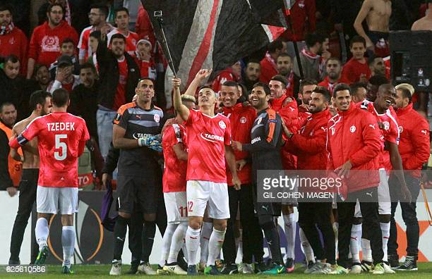 Hapoel's players celebrate after winning the UEFA Europa League group K football match between Israel's Hapoel Beer Sheva and Italy's Inter Milan on...