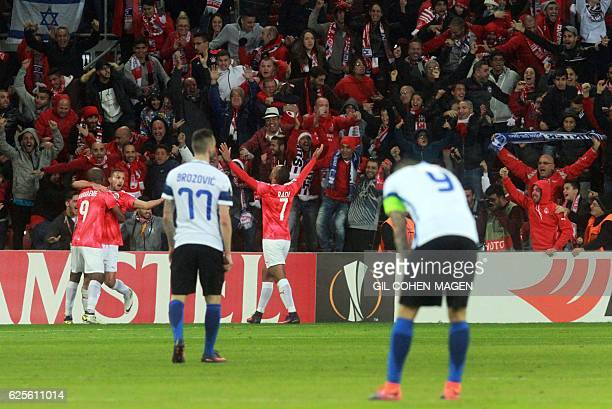 Hapoel's players celebrate with their fans after winning the UEFA Europa League group K football match between Israel's Hapoel Beer Sheva and Italy's...