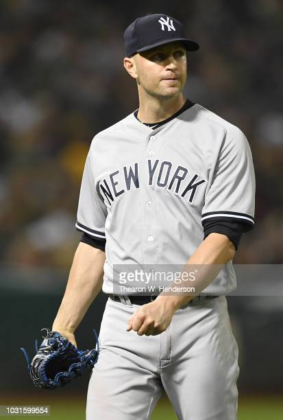 A Happ of the New York Yankees looks on as he walks back to the dugout after he was taken out of the game against the Oakland Athletics in the bottom...