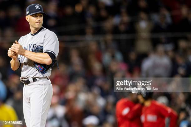 A Happ of the New York Yankees reacts as he exits the game during the third inning of game one of the American League Division Series against the...