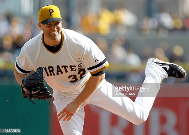 A Happ of the Pittsburgh Pirates pitches in the first inning during the game against the Cincinnati Reds at PNC Park on October 4 2015 in Pittsburgh...
