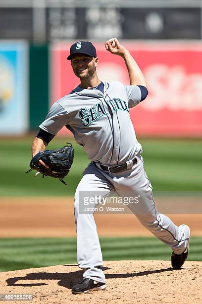 A Happ of the Seattle Mariners pitches against the Oakland Athletics during the first inning at Oco Coliseum on April 11 2015 in Oakland California