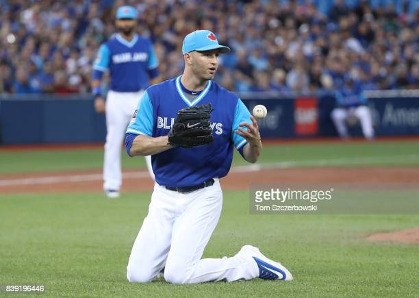 A Happ of the Toronto Blue Jays bobbles a soft RBI single hit by Byron Buxton of the Minnesota Twins in the third inning during MLB game action at...