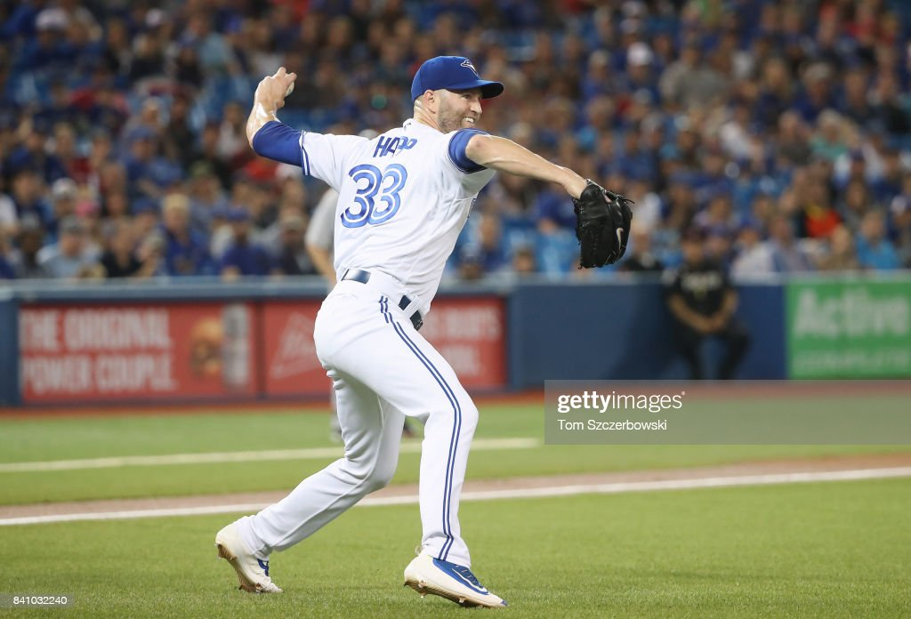 J.A. Happ #33 of the Toronto Blue Jays comes off the mound to make the play on a soft grounder to throw out Mookie Betts of the Boston Red Sox in the first inning during MLB game action at Rogers Centre on August 30, 2017 in Toronto, Canada.