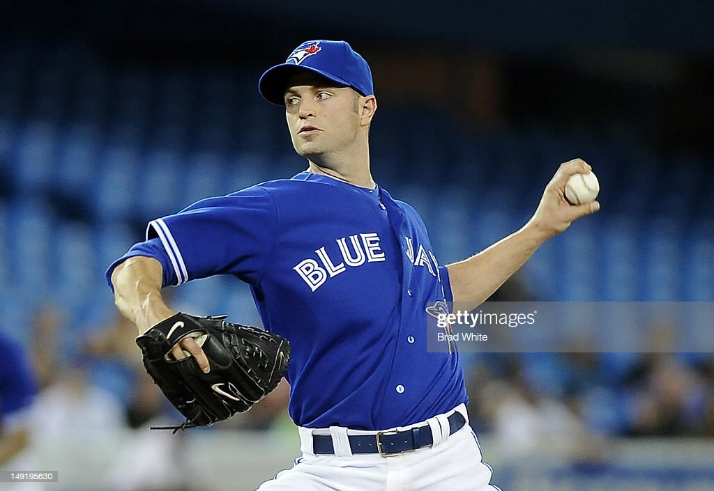 J.A. Happ #48 of the Toronto Blue Jays delivers a pitch during MLB game action against the Oakland Athletics July 24, 2012 at Rogers Centre in Toronto, Ontario, Canada.