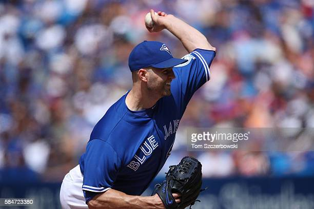 A Happ of the Toronto Blue Jays delivers a pitch in the eighth inning during MLB game action against the Baltimore Orioles on July 30 2016 at Rogers...