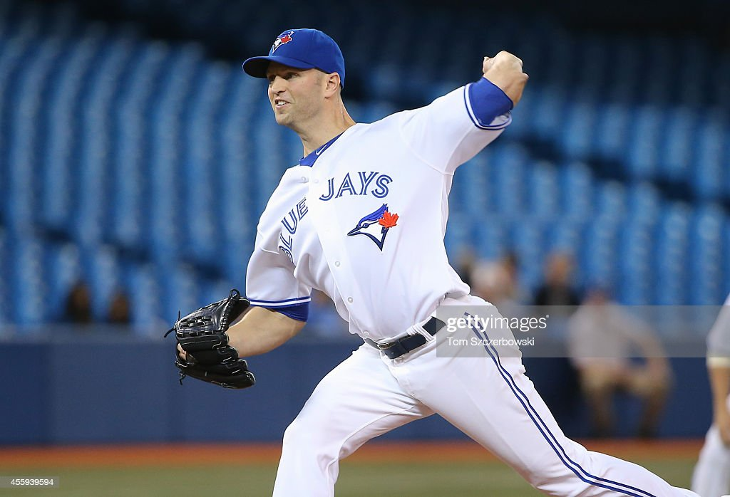 J.A. Happ #48 of the Toronto Blue Jays delivers a pitch in the first inning during MLB game action against the Seattle Mariners on September 22, 2014 at Rogers Centre in Toronto, Ontario, Canada.