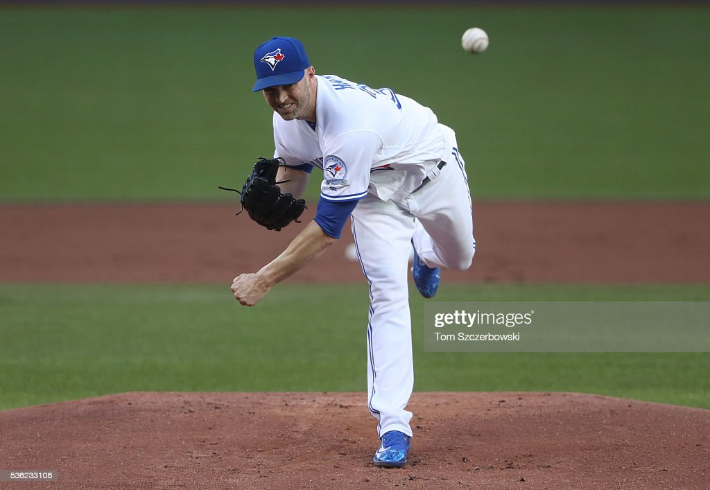 J.A. Happ #33 of the Toronto Blue Jays delivers a pitch in the first inning during MLB game action against the New York Yankees on May 31, 2016 at Rogers Centre in Toronto, Ontario, Canada.