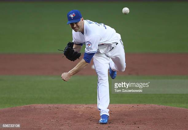 A Happ of the Toronto Blue Jays delivers a pitch in the first inning during MLB game action against the New York Yankees on May 31 2016 at Rogers...