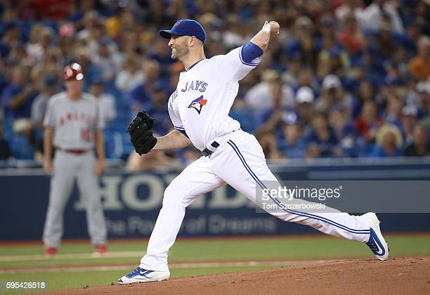 A Happ of the Toronto Blue Jays delivers a pitch in the first inning during MLB game action against the Los Angeles Angels of Anaheim on August 25...