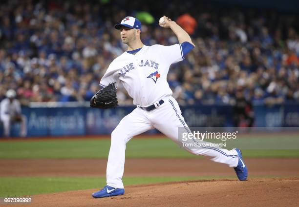 A Happ of the Toronto Blue Jays delivers a pitch in the first inning during MLB game action against the Milwaukee Brewers at Rogers Centre on April...