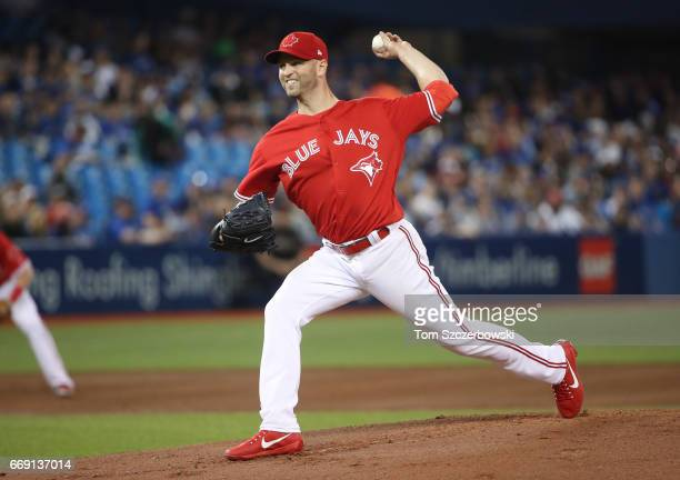 A Happ of the Toronto Blue Jays delivers a pitch in the first inning during MLB game action against the Baltimore Orioles at Rogers Centre on April...