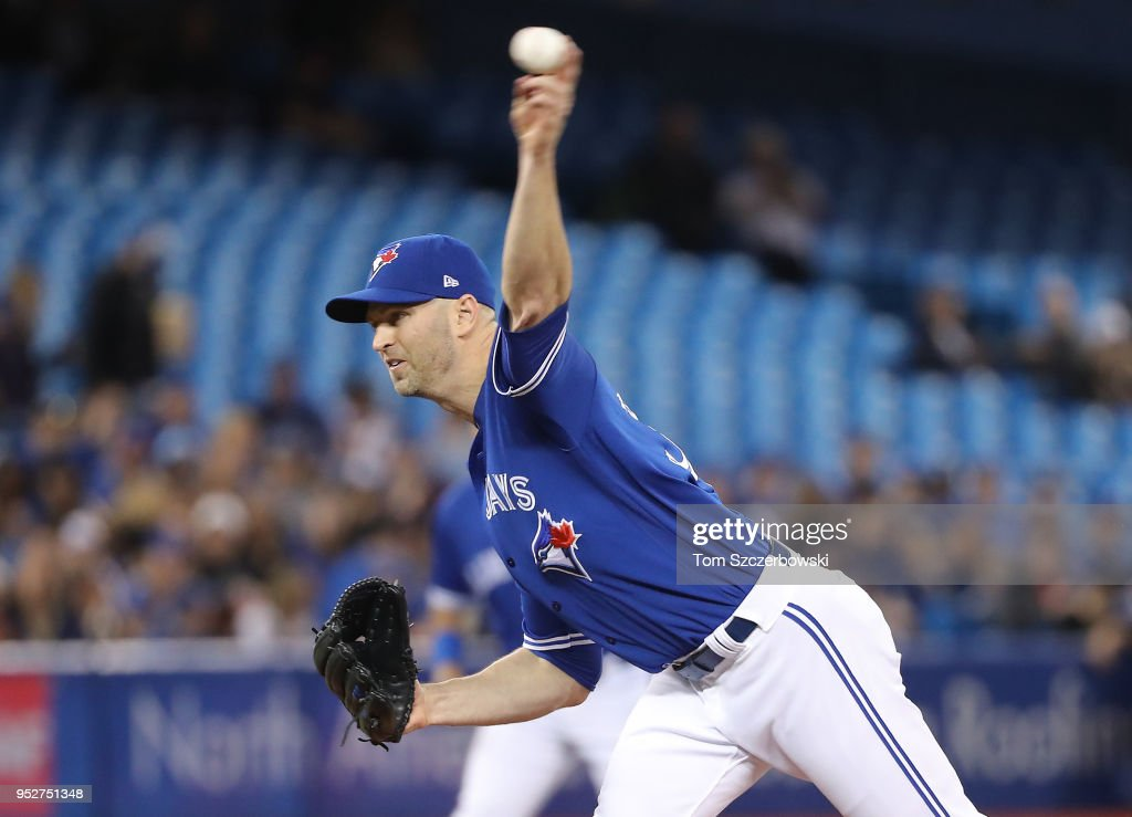 J.A. Happ #33 of the Toronto Blue Jays delivers a pitch in the first inning during MLB game action against the Texas Rangers at Rogers Centre on April 29, 2018 in Toronto, Canada.