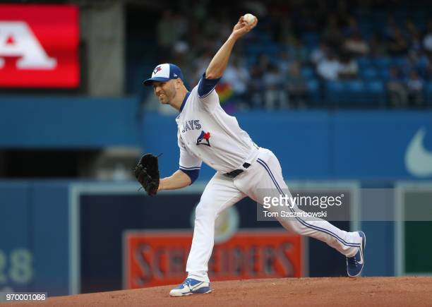 A Happ of the Toronto Blue Jays delivers a pitch in the first inning during MLB game action against the Baltimore Orioles at Rogers Centre on June 8...