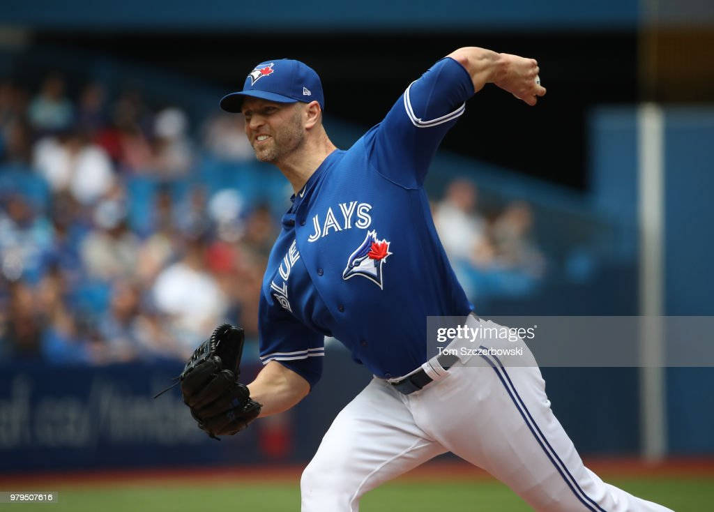 J.A. Happ #33 of the Toronto Blue Jays delivers a pitch in the first inning during MLB game action against the Atlanta Braves at Rogers Centre on June 20, 2018 in Toronto, Canada.