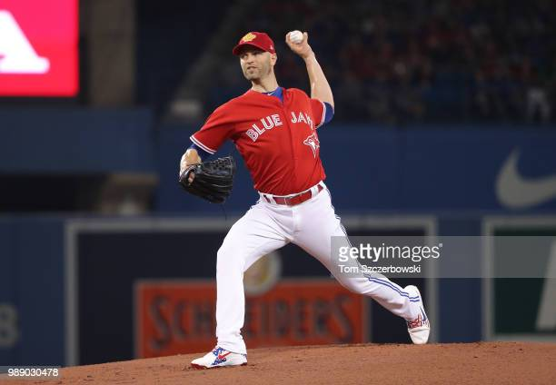 A Happ of the Toronto Blue Jays delivers a pitch in the first inning during MLB game action against the Detroit Tigers at Rogers Centre on July 1...