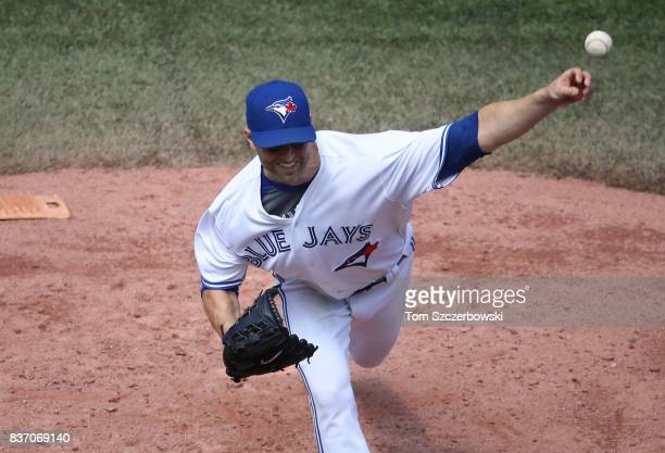 A Happ of the Toronto Blue Jays delivers a pitch in the third inning during MLB game action against the Pittsburgh Pirates at Rogers Centre on August...